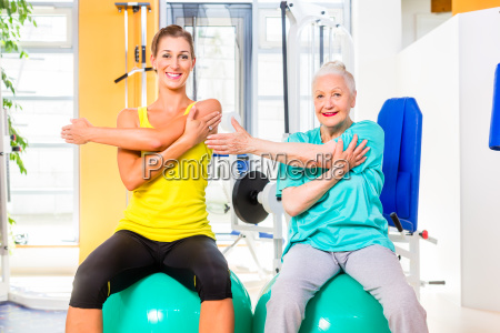 senior and young woman working out