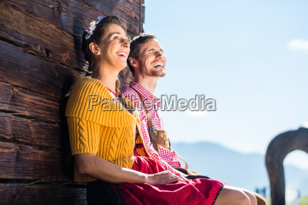 couple in traditional clothing front of