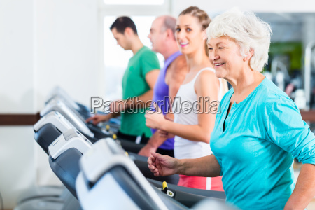group with senior people on treadmill