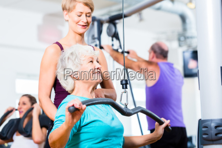 senior woman doing back training with