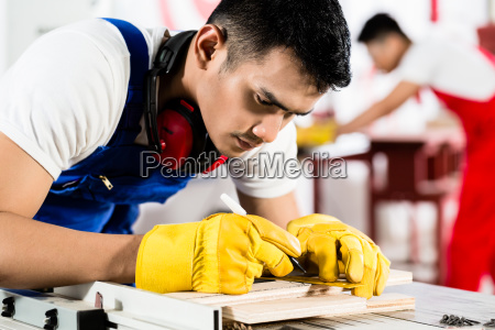 diligent worker in factory working on