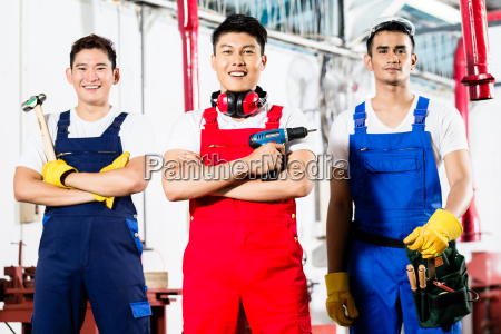 workers with tools in asian industrial