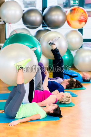 young and senior people exercising with