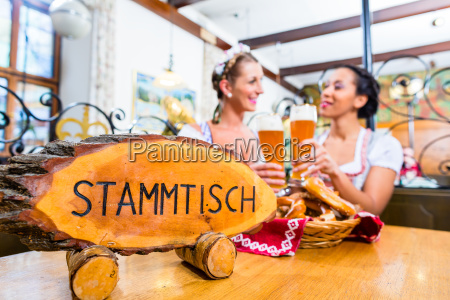 friends in bavarian inn toasting with