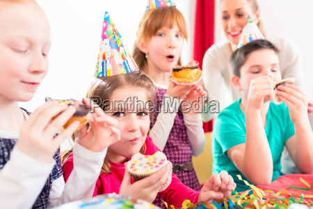 children at birthday party with muffins