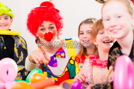 clown at children birthday party with