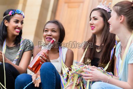 girls having drink together on bachelorette
