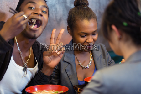 group of young black people dining