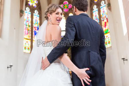 bride grabbing ass of groom at