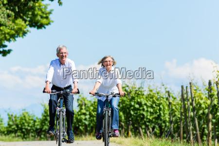 senior woman and man having picnic
