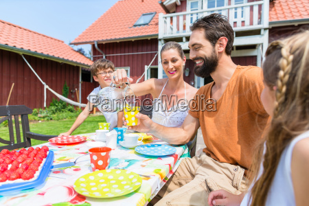 family drinking coffee and eating cake