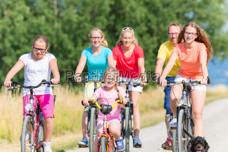 family on bikes at dirt path