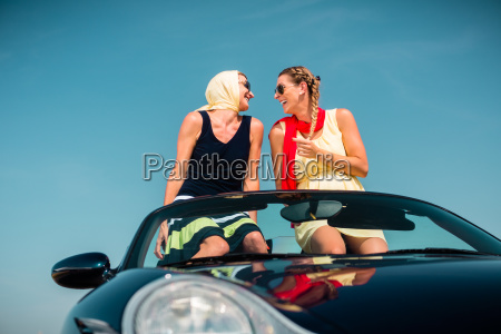 woman having summer trip in convertible