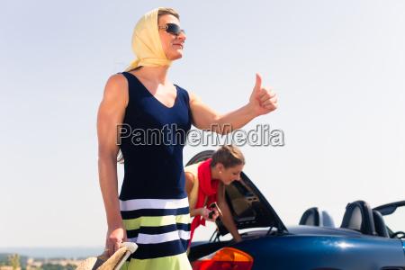 two women having engine breakdown on