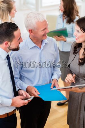 business woman in office showing boss