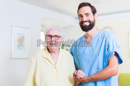 geriatric nurse and senior in old