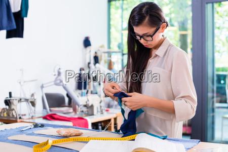 asian fashion designer woman drafts cut