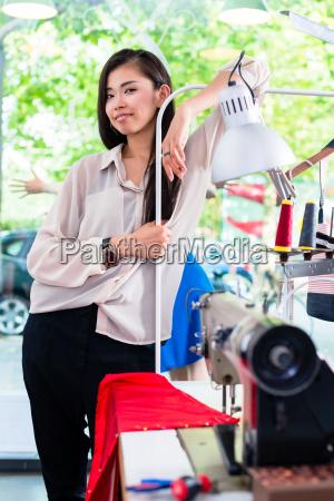 asian tainlor or fashion designer leans