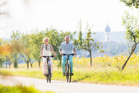 senior couple woman and man riding