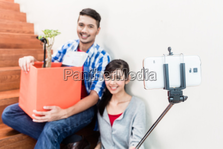 asian couple taking selfie from their