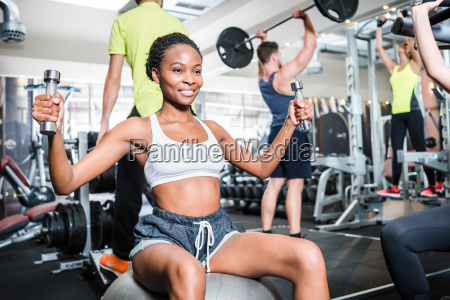 girl in fitness gym exercising her
