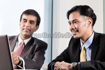 senior manager and junior professional having