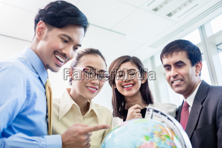 businesspeople talk about global strategy