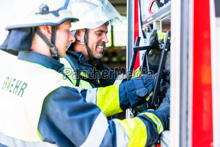 fire fighter checking the hoses at