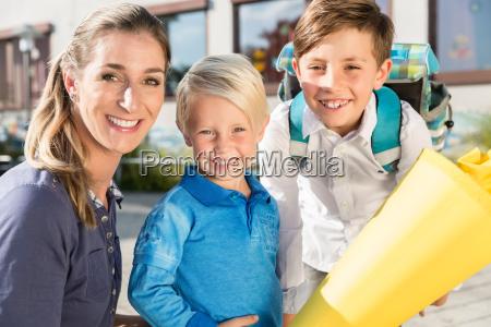woman and kids at enrolment day