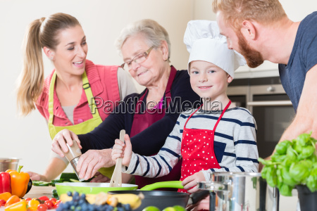 family cooking in multigenerational household with