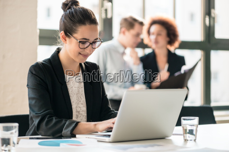 hard working young woman analyzing business