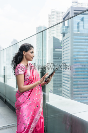 confident business woman using a tablet