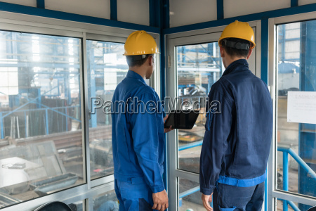 two workers wearing hard hats while