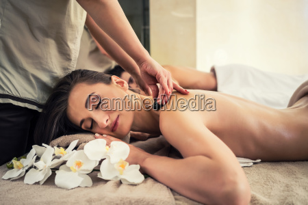 woman enjoying traditional hot stone massage