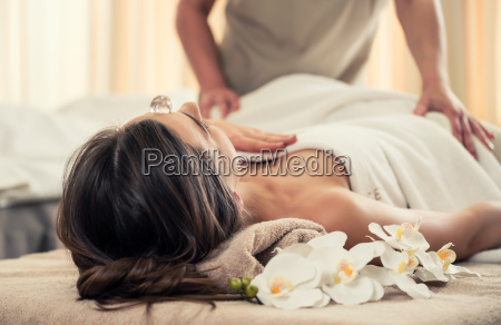 woman relaxing under the therapeutic effect