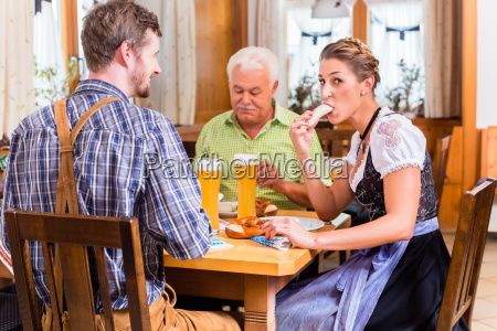 man and woman eating in bavarian