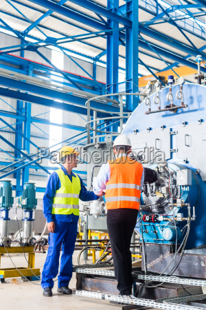 worker and manager in industrial factory