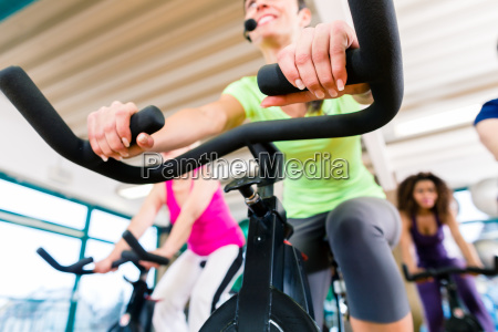 woman at fitness spinning on bike