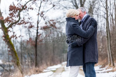 senior woman and man embracing each
