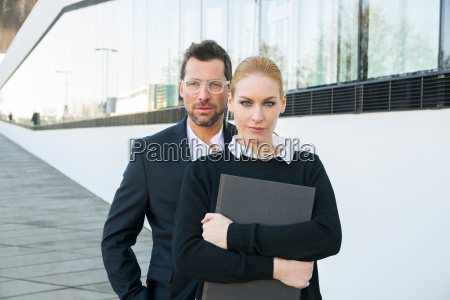 portrait of confident businessman and woman