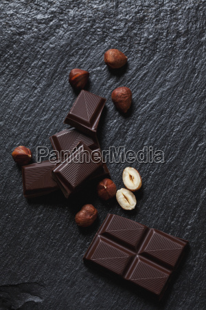 bittersweet chocolate and hazelnuts on slate