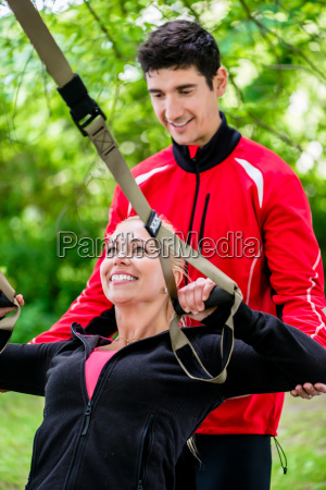sport woman with trainer at sling