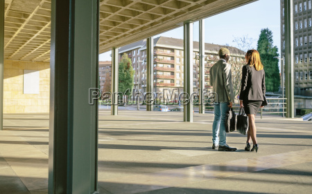 young businessman and woman talking by