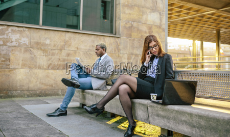 young businessman and woman sitting on