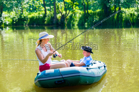 couple in boat on pond or
