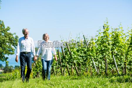 senior woman and man having walk