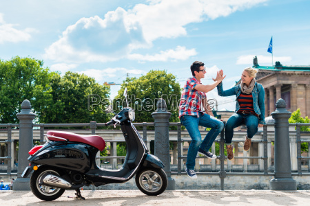 tourist couple making stop during vespa