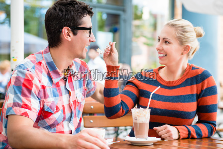 couple having coffee in a street
