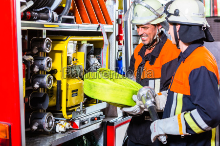 fire fighters loading hoses into operations