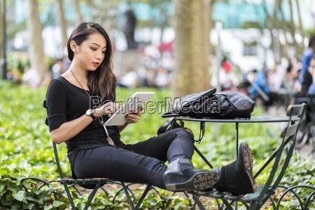 usa new york young woman sitting